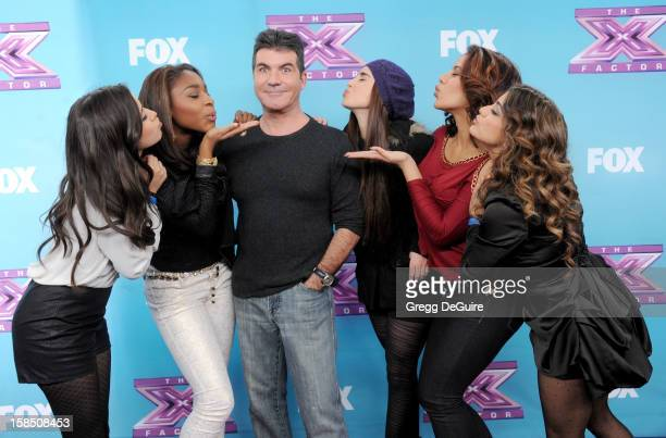 Simon Cowell and singer's Fifth Harmony arrive at 'The X Factor' season finale press conference at CBS Studios on December 17 2012 in Los Angeles...