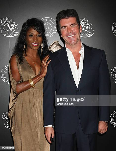 Simon Cowell and Sinitta arrive for the Collars and Cuffs Ball at the Royal Opera House on September 17 2009 in London England