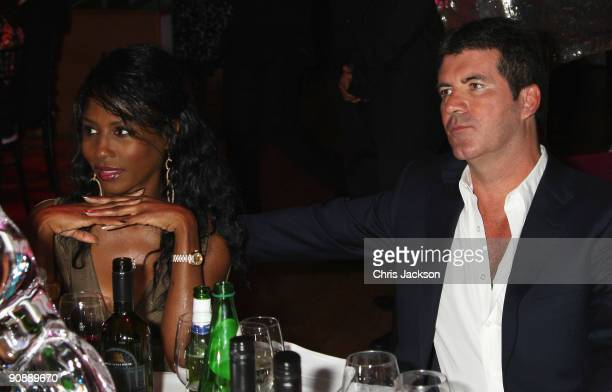 Simon Cowell and Sinitta attend the Collars and Cuffs Ball at the Royal Opera House on September 17 2009 in London England