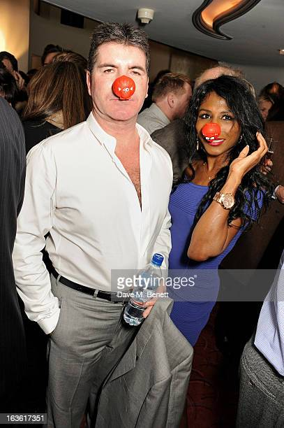 Simon Cowell and Sinitta attends a gala performance of 'The Book Of Mormon' in aid of Red Nose Day at the Prince Of Wales Theatre on March 13 2013 in...