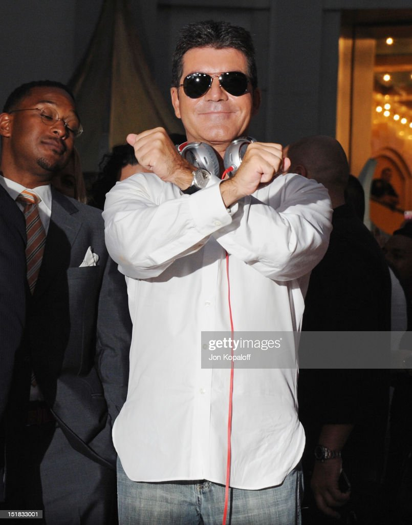 <a gi-track='captionPersonalityLinkClicked' href=/galleries/search?phrase=Simon+Cowell&family=editorial&specificpeople=203007 ng-click='$event.stopPropagation()'>Simon Cowell</a> arrives at 'The X Factor' Season Two Premiere at Grauman's Chinese Theatre on September 11, 2012 in Hollywood, California.