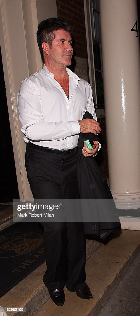 <a gi-track='captionPersonalityLinkClicked' href=/galleries/search?phrase=Simon+Cowell&family=editorial&specificpeople=203007 ng-click='$event.stopPropagation()'>Simon Cowell</a> at the Arts club on April 5, 2014 in London, England.