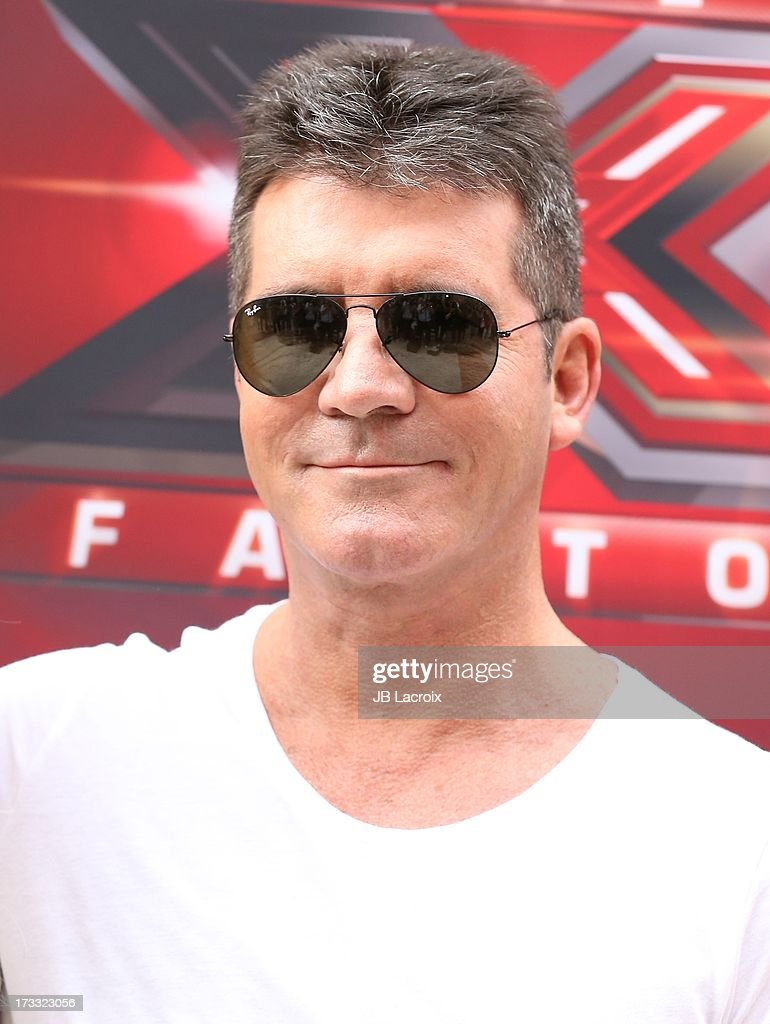 <a gi-track='captionPersonalityLinkClicked' href=/galleries/search?phrase=Simon+Cowell&family=editorial&specificpeople=203007 ng-click='$event.stopPropagation()'>Simon Cowell</a> attend Fox's 'The X Factor' Judges at Galen Center on July 11, 2013 in Los Angeles, California.