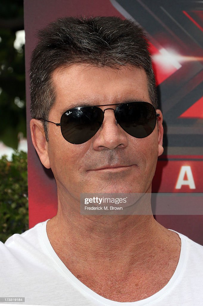 <a gi-track='captionPersonalityLinkClicked' href=/galleries/search?phrase=Simon+Cowell&family=editorial&specificpeople=203007 ng-click='$event.stopPropagation()'>Simon Cowell</a> attends Fox's 'The X Factor' Judges at the Galen Center on July 11, 2013 in Los Angeles, California.