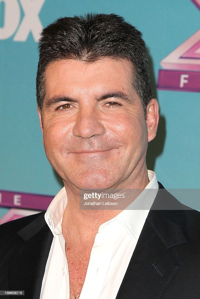 <a gi-track='captionPersonalityLinkClicked' href=/galleries/search?phrase=Simon+Cowell&family=editorial&specificpeople=203007 ng-click='$event.stopPropagation()'>Simon Cowell</a> attends the FOX's 'The X Factor' Season Finale - Night 2 at CBS Television City on December 20, 2012 in Los Angeles, California.