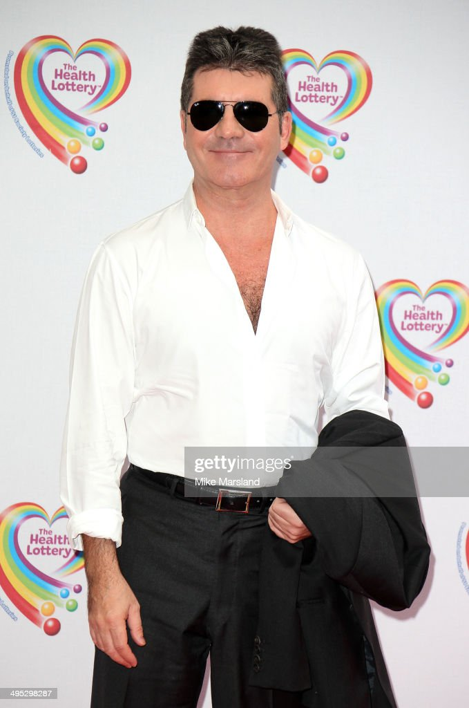<a gi-track='captionPersonalityLinkClicked' href=/galleries/search?phrase=Simon+Cowell&family=editorial&specificpeople=203007 ng-click='$event.stopPropagation()'>Simon Cowell</a> attends the Health Lottery tea party at The Savoy Hotel on June 2, 2014 in London, England.