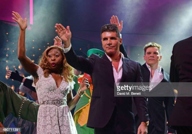 Simon Cowell bows with cast members Cynthia Erivo and Nigel Harman at the curtain call during the press night performance of 'I Can't Sing The X...