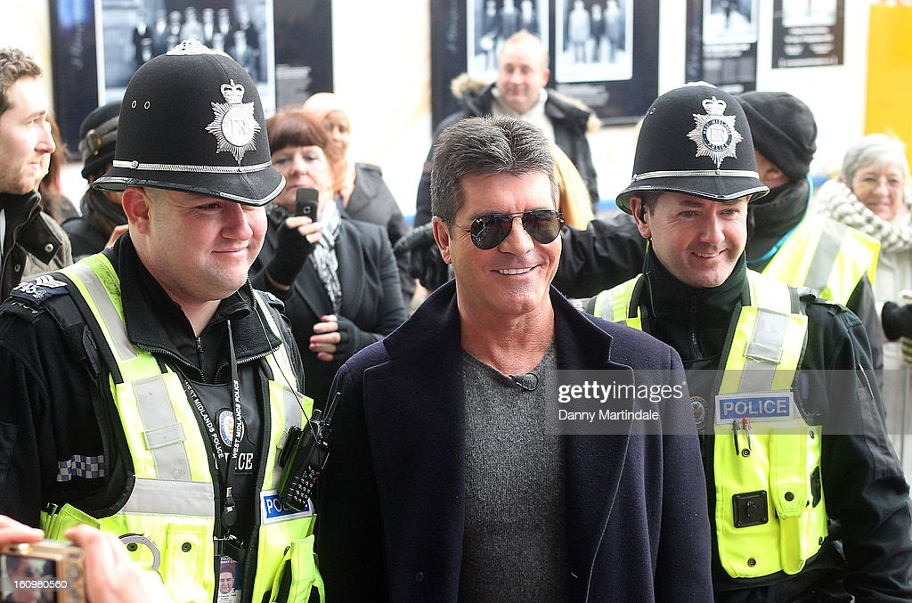 <a gi-track='captionPersonalityLinkClicked' href=/galleries/search?phrase=Simon+Cowell&family=editorial&specificpeople=203007 ng-click='$event.stopPropagation()'>Simon Cowell</a> has his picture taken with police at the Birmingham auditions of Britain's Got Talent at The ICC on February 8, 2013 in Birmingham, England.