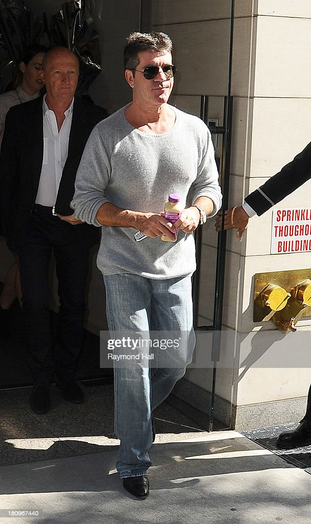 Simon Cowell is seen leaving his Hotel on September 18, 2013 in New York City.