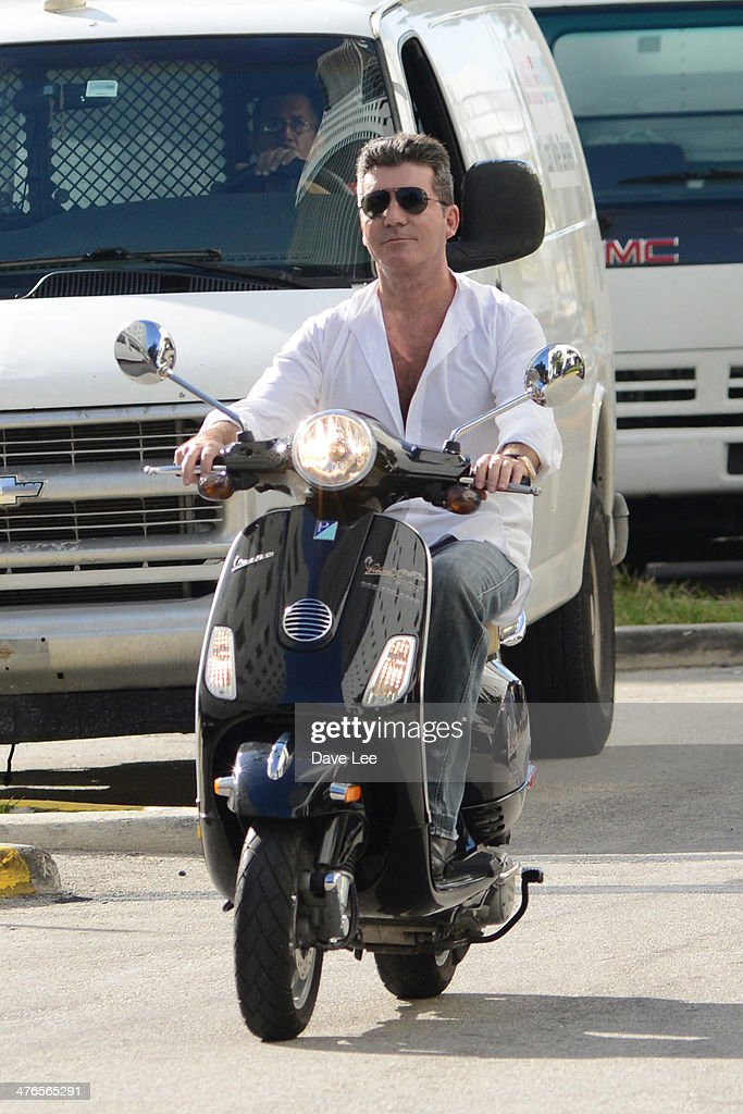 <a gi-track='captionPersonalityLinkClicked' href=/galleries/search?phrase=Simon+Cowell&family=editorial&specificpeople=203007 ng-click='$event.stopPropagation()'>Simon Cowell</a> is seen riding a scooter on March 03, 2014 in Miami Beach, Florida.