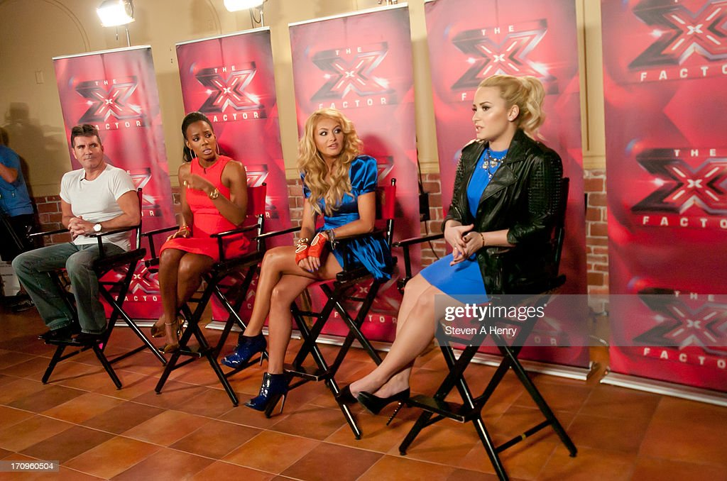 Simon Cowell, Kelly Rowland, Paulina Rubio and Demi Lovato attend the 'The X Factor' Judges press conference at Nassau Veterans Memorial Coliseum on June 20, 2013 in Uniondale, New York.