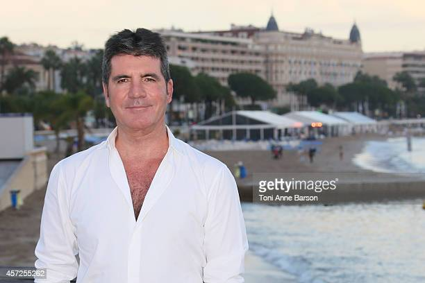 Simon Cowell MIPCOM Personality of the Year poses during a photocall at Mipcom 2014 on October 13 2014 in Cannes France