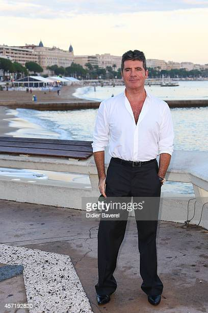 Simon Cowell poses during a photocall at Mipcom 2014 on October 13 2014 in Cannes France