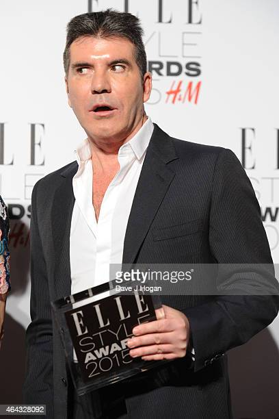 Simon Cowell poses in the Winners room with his award for TV Personality at the Elle Style Awards 2015 at Sky Garden @ The Walkie Talkie Tower on...