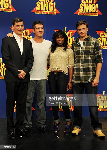 Simon Cowell poses with cast members Nigel Harman Cynthia Erivo and Alan Morrissey at a photocall to launch 'I Can't Sing The X Factor Musical' at...