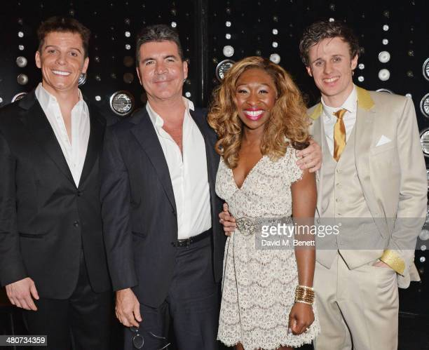 Simon Cowell poses with cast members Nigel Harman Cynthia Erivo and Alan Morrissey backstage at the press night performance of 'I Can't Sing The X...