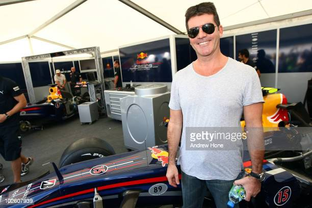Simon Cowell visits the Red Bull Racing garage and poses for a picture with the car during day two of The Goodwood Festival of Speed at The Goodwood...