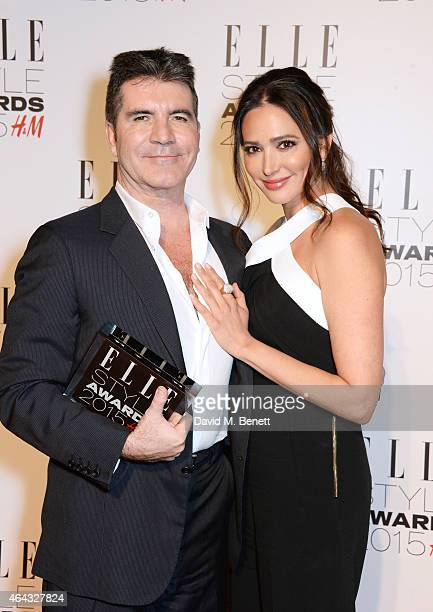 Simon Cowell winner of the Outstanding Contribution to Entertainment award and Lauren Silverman pose in the Winners Room at the Elle Style Awards...