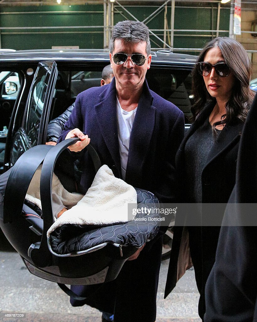 <a gi-track='captionPersonalityLinkClicked' href=/galleries/search?phrase=Simon+Cowell&family=editorial&specificpeople=203007 ng-click='$event.stopPropagation()'>Simon Cowell</a> with his partner <a gi-track='captionPersonalityLinkClicked' href=/galleries/search?phrase=Lauren+Silverman&family=editorial&specificpeople=4501937 ng-click='$event.stopPropagation()'>Lauren Silverman</a> and newborn son <a gi-track='captionPersonalityLinkClicked' href=/galleries/search?phrase=Eric+Cowell&family=editorial&specificpeople=12480812 ng-click='$event.stopPropagation()'>Eric Cowell</a> are seen arriving at their hotel on February 16, 2014 in New York City.