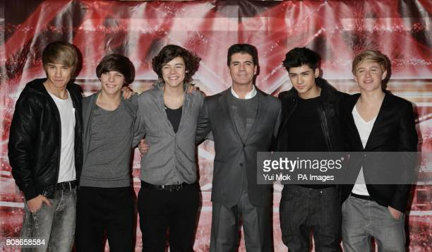Simon Cowell with One Direction Liam Payne Louis Tomlinson Harry Styles Zayn Malik and Niall Horan attending a press conference for X Factor at The...
