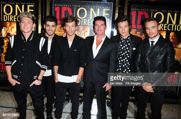 Simon Cowell with One Direction's Niall Horan Zayn Malik Louis Tomlinson Harry Styles and Liam Payne at the World Premiere of One Direction This Is...