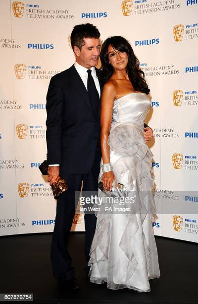 Simon Cowell with the Special Award and Jackie St Clair at the BAFTA television awards at the London Palladium