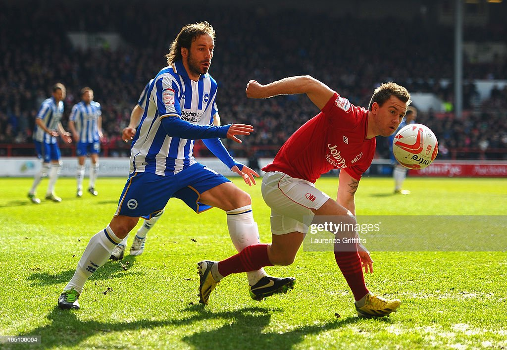 Simon Cox of Nottingham Forest battles with Inigo Calderon of Brighton during the npower Championship match between Nottingham Forest and Brighton and Hove Albion at City Ground on March 30, 2013 in Nottingham, England.