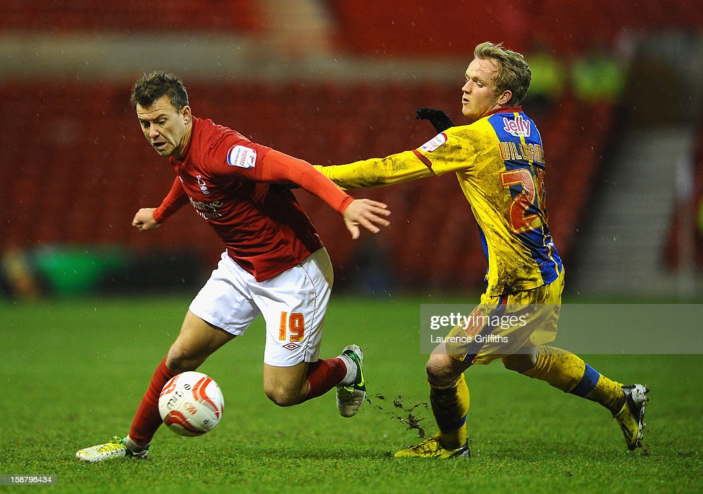 Simon Cox of Nottingham Forest battles with Jonathan Williams of Crystal Palace during the npower Championship match between Nottingham Forest and Crystal Palace at City Ground on December 29, 2012 in Nottingham, England.
