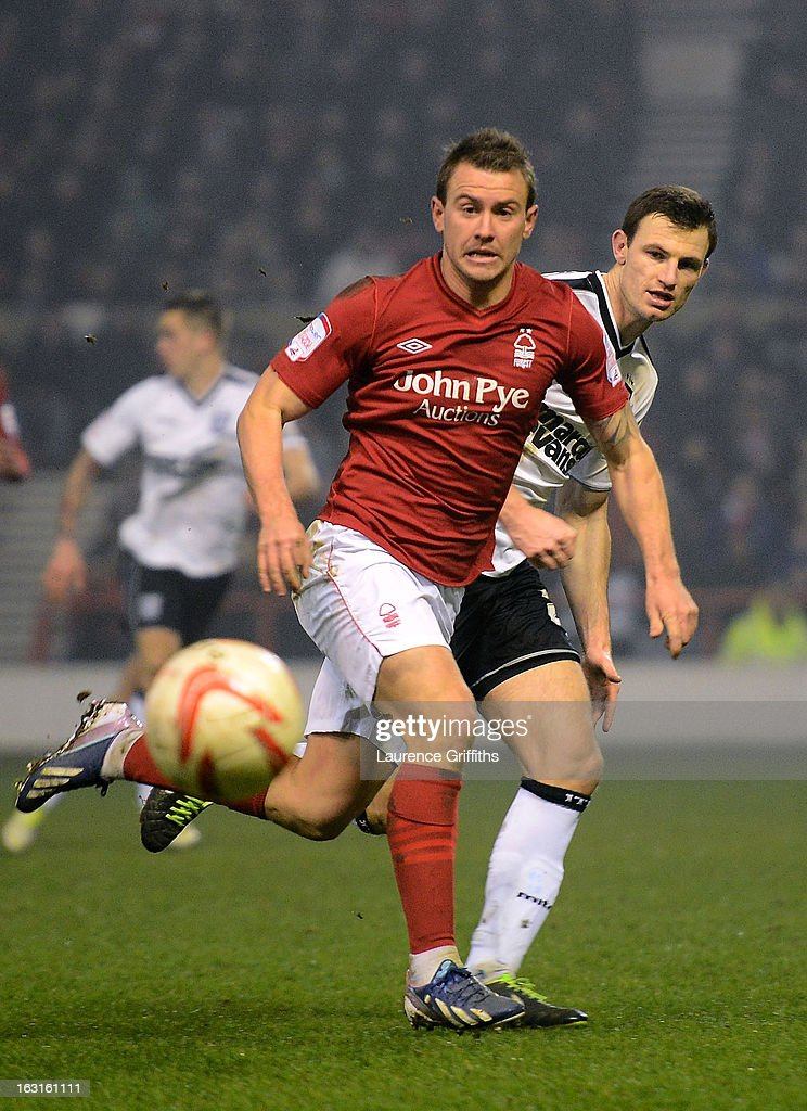 Simon Cox of Nottingham Forest is shadowed by Tommy Smith of Ipswich during the npower Championship match between Nottingham Forest and Ipswich Town at City Ground on March 5, 2013 in Nottingham, England.