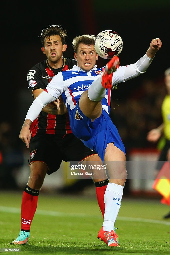 Simon Cox of Reading is closely watched by Charlie Daniels of Bournemouth during the Sky Bet Championship match between AFC Bournemouth and Reading...