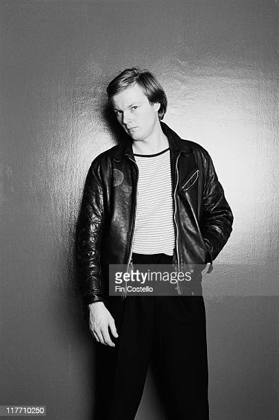 Simon Crowe drummer with Irish punk band The Boomtown Rats wearing a black leather jacket and striped tshirt in a studio portrait in February 1979
