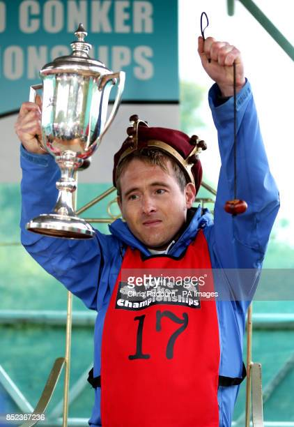 Simon Cullum from Kettering celebrate after being crowned the Conker King after winning the World Conker Championships at the Shuckburgh Arms in...