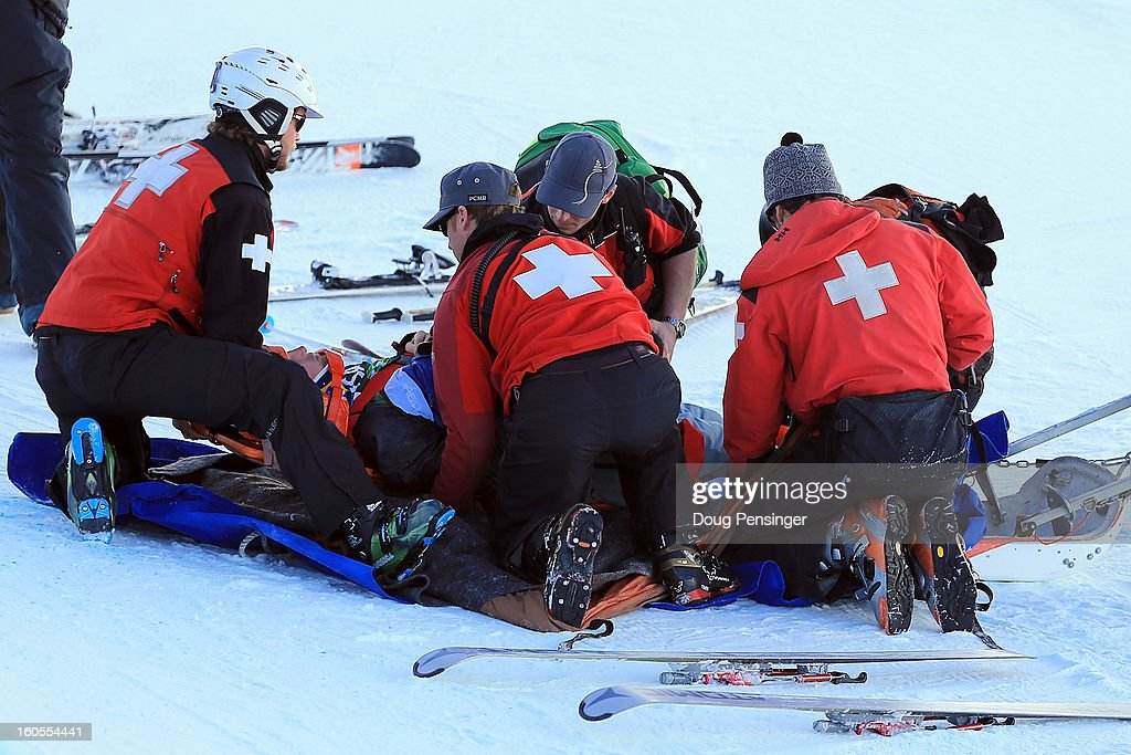 Simon D'Artois of Canada is taken from the halfpipe by ski patrol and medical personnel after falling on his first run in the finals of the FIS Freestyle Ski Halfpipe World Cup during the Sprint U.S. Grand Prix at Park City Mountain on February 2, 2013 in Park City, Utah.