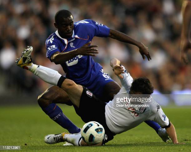 Simon Davies of Fulham and Fabrice Muamba of Bolton battle for the ball during the Barclays Premier League match between Fulham and Bolton Wanderers...