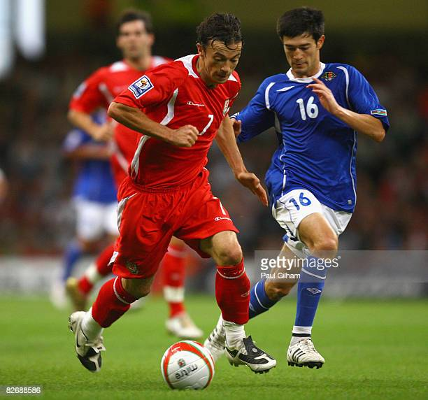Simon Davies of Wales battles for the ball with Elvin Mamedov of Azerbaijan during the FIFA 2010 World Cup Group Four Qualifying match between Wales...