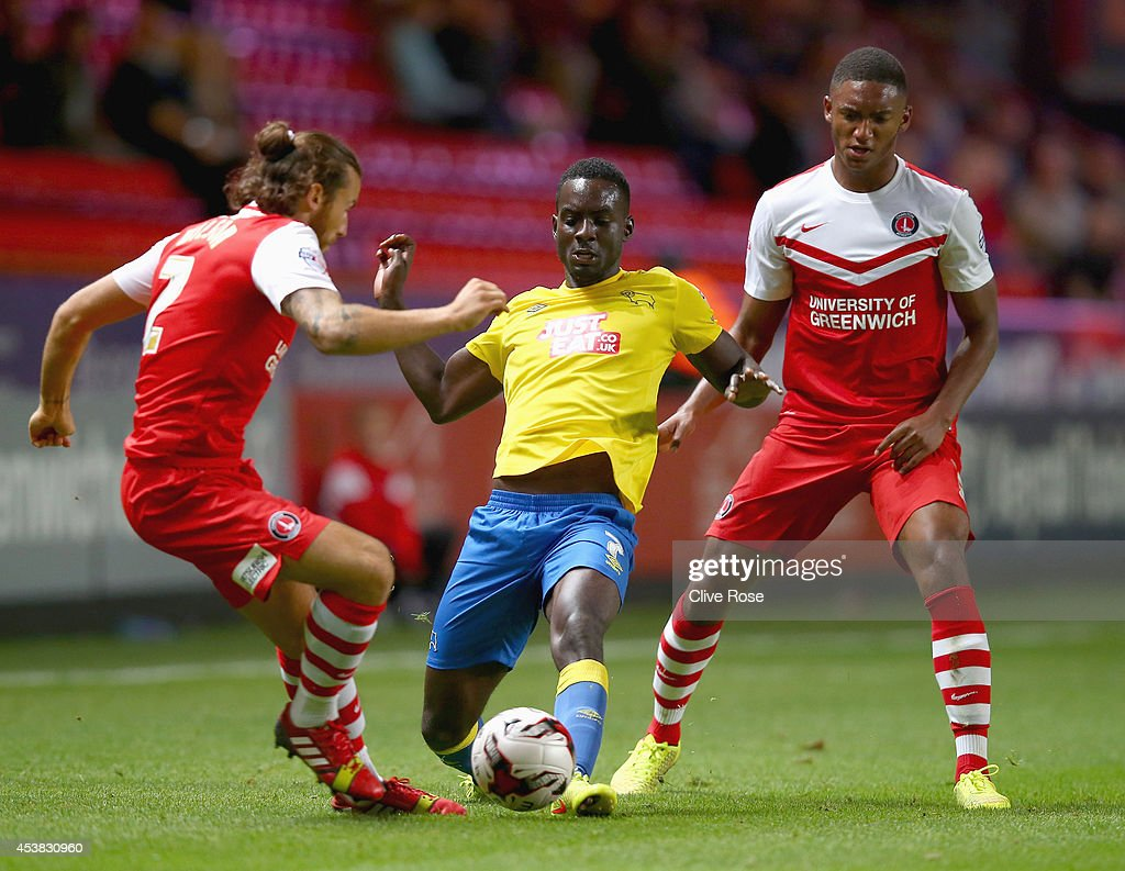 <a gi-track='captionPersonalityLinkClicked' href=/galleries/search?phrase=Simon+Dawkins&family=editorial&specificpeople=7575589 ng-click='$event.stopPropagation()'>Simon Dawkins</a> of Derby County is challenged by Joe Gomez of Charlton during the Sky Bet Championship match between Charlton Athletic and Derby County at The Valley on August 19, 2014 in London, England.