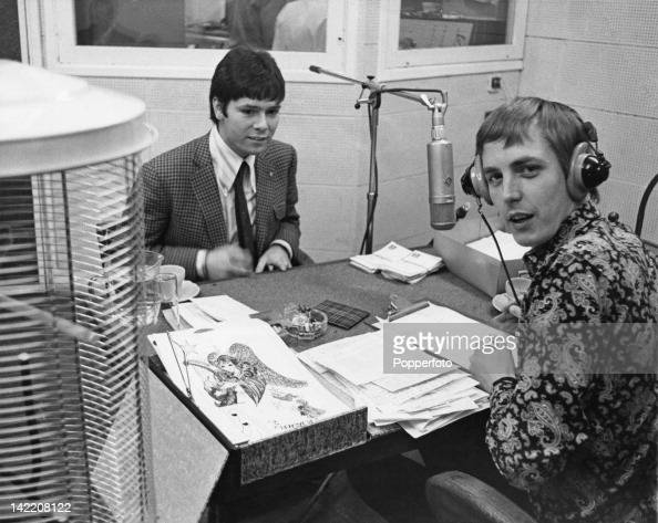 DJ Simon Dee with singer Cliff Richard at the Radio Luxembourg studios in London 13th December 1967 On the left is a golden birdcage containing a...