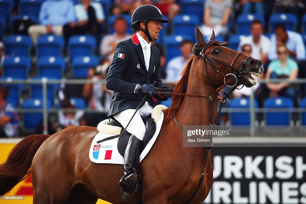 <a gi-track='captionPersonalityLinkClicked' href=/galleries/search?phrase=Simon+Delestre&family=editorial&specificpeople=2331561 ng-click='$event.stopPropagation()'>Simon Delestre</a> of France competes on his horse Ryan des Hayettes during the Mercedes-Benz Prize Team Show Jumping competition on Day 9 of the FEI European Equestrian Championship 2015 on August 20, 2015 in Aachen, Germany.