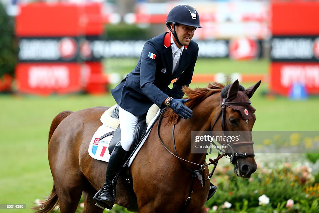 <a gi-track='captionPersonalityLinkClicked' href=/galleries/search?phrase=Simon+Delestre&family=editorial&specificpeople=2331561 ng-click='$event.stopPropagation()'>Simon Delestre</a> of France rides on Ryan des Hayettes and celebrates after winning the third place of the Rolex European Champion jumping competition on Day 12 of the FEI European Equestrian Championship 2015 on August 23, 2015 in Aachen, Germany.
