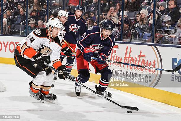 Simon Depres of the Anaheim Ducks and Rene Bourque of the Columbus Blue Jackets chase after a loose puck on February 11 2016 at Nationwide Arena in...