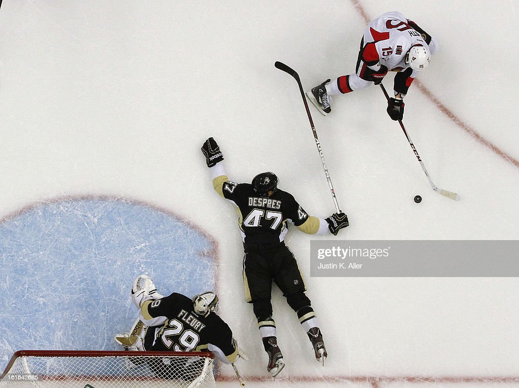 Simon Despres #47 lays down to block a shot in front of Marc-Andre Fleury #29 of the Pittsburgh Penguins during the game Zack Smith #15 of the Ottawa Senators at Consol Energy Center on February 13, 2013 in Pittsburgh, Pennsylvania. The Penguins won 4-2.