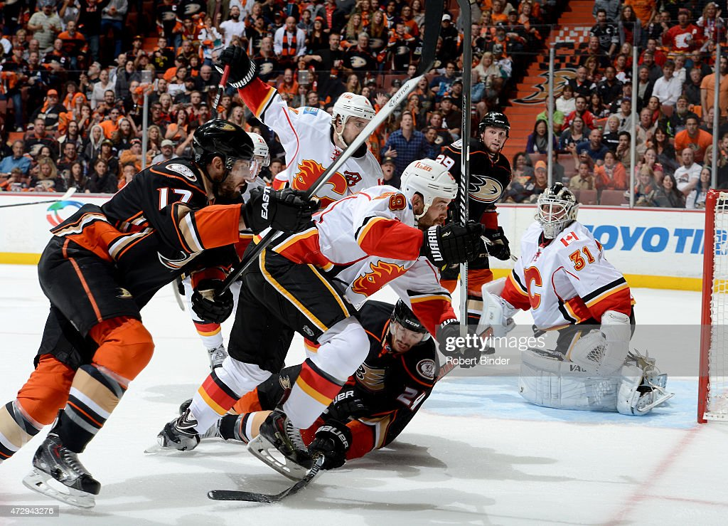 Simon Despres #24 of the Anaheim Ducks battles for the puck against Deryk Engelland #29 of the Calgary Flames in Game Five of the Western Conference Semifinals during the 2015 NHL Stanley Cup Playoffs at Honda Center on May 10, 2015 in Anaheim, California.