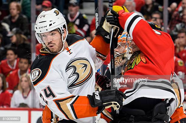 Simon Despres of the Anaheim Ducks hits Richard Panik of the Chicago Blackhawks next to goalie John Gibson in the second period of the NHL game at...
