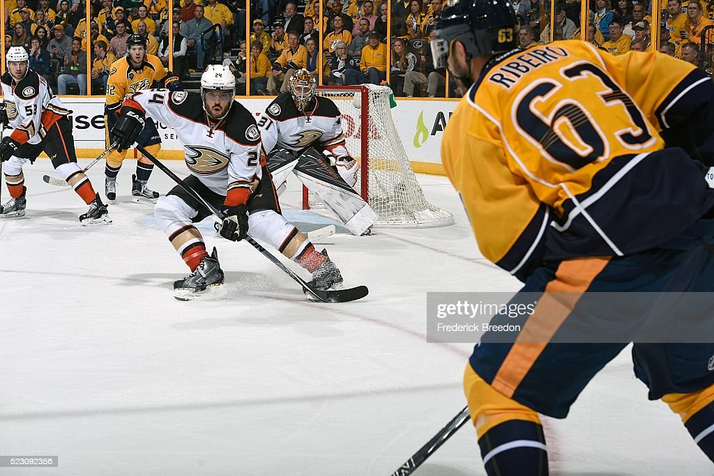 Simon Despres #24 of the Anaheim Ducks watches Mike Ribiero #63 of the Nashville Predators carry the puck during the third period in Game Four of the Western Conference First Round during the 2016 NHL Stanley Cup Playoffs at Bridgestone Arena on April 19, 2016 in Nashville, Tennessee.