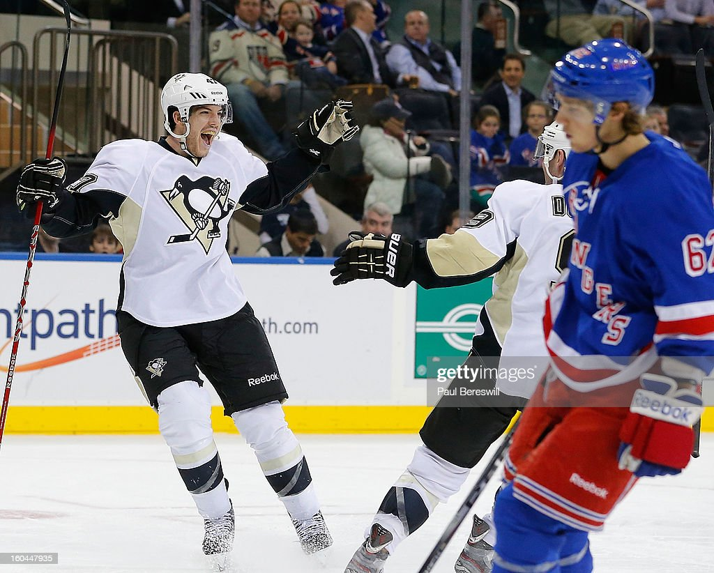 <a gi-track='captionPersonalityLinkClicked' href=/galleries/search?phrase=Simon+Despres&family=editorial&specificpeople=4649466 ng-click='$event.stopPropagation()'>Simon Despres</a> #47 of the Pittsburgh Penguins celebrates scoring the third goal of the game for Pittsburgh as Carl Hagelin #62 of the New York Rangers skates away in the third period of an NHL hockey game at Madison Square Garden on January 31, 2013 in New York City.