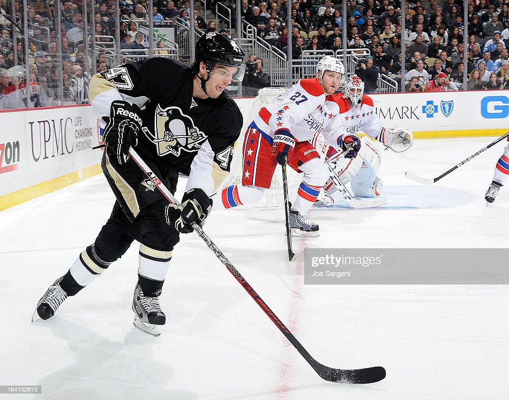Simon Despres #47 of the Pittsburgh Penguins skates with the puck in front of <a gi-track='captionPersonalityLinkClicked' href=/galleries/search?phrase=Karl+Alzner&family=editorial&specificpeople=3938829 ng-click='$event.stopPropagation()'>Karl Alzner</a> #27 of the Washington Capitals on March 19, 2013 at Consol Energy Center in Pittsburgh, Pennsylvania. Pittsburgh won the game 2-1.