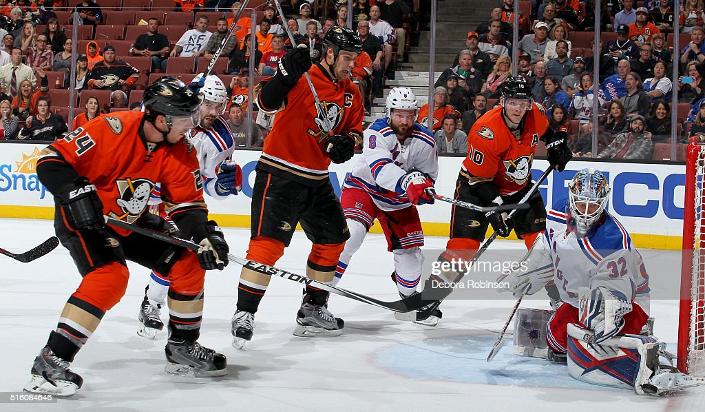 Simon Despres #24, Ryan Getzlaf #15 and Corey Perry #10 of the Anaheim Ducks battle for the puck against Keith Yandle #93, Kevin Klein #8 and Antti Raanta #32 of the New York Rangers on March 16, 2016 at Honda Center in Anaheim, California.