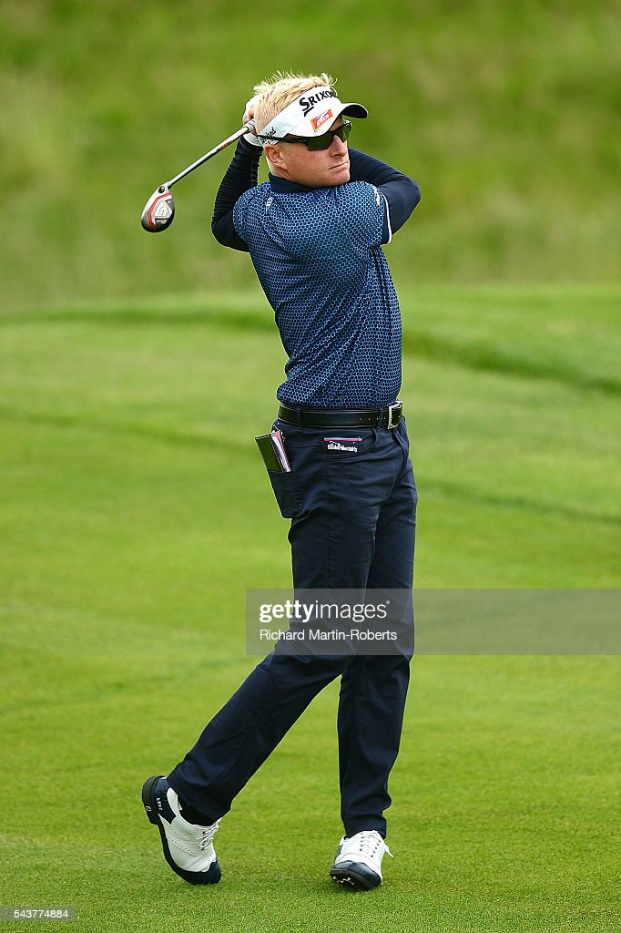 <a gi-track='captionPersonalityLinkClicked' href=/galleries/search?phrase=Simon+Dyson&family=editorial&specificpeople=214775 ng-click='$event.stopPropagation()'>Simon Dyson</a> of England hits his 2nd shot on the 17th hole during the first round of the 100th Open de France at Le Golf National on June 30, 2016 in Paris, France.