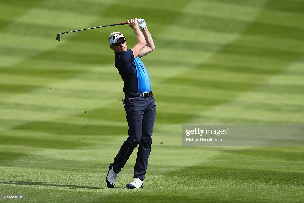 <a gi-track='captionPersonalityLinkClicked' href=/galleries/search?phrase=Simon+Dyson&family=editorial&specificpeople=214775 ng-click='$event.stopPropagation()'>Simon Dyson</a> of England hits his 2nd shot on the 4th hole during day one of the BMW PGA Championship at Wentworth on May 26, 2016 in Virginia Water, England.