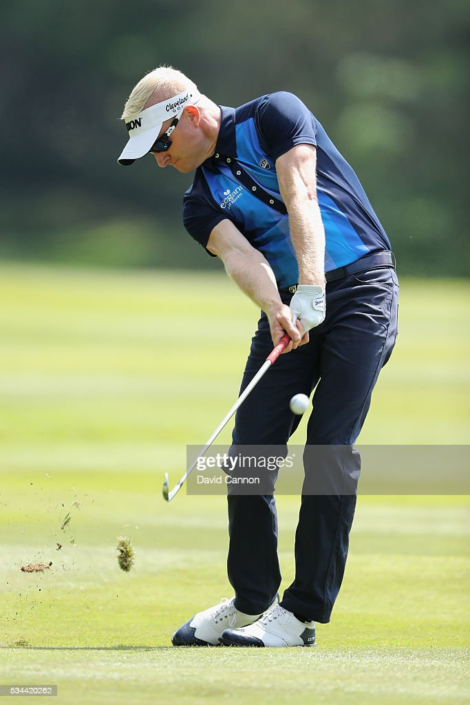 <a gi-track='captionPersonalityLinkClicked' href=/galleries/search?phrase=Simon+Dyson&family=editorial&specificpeople=214775 ng-click='$event.stopPropagation()'>Simon Dyson</a> of England hits his 2nd shot on the 9th hole during day one of the BMW PGA Championship at Wentworth on May 26, 2016 in Virginia Water, England.